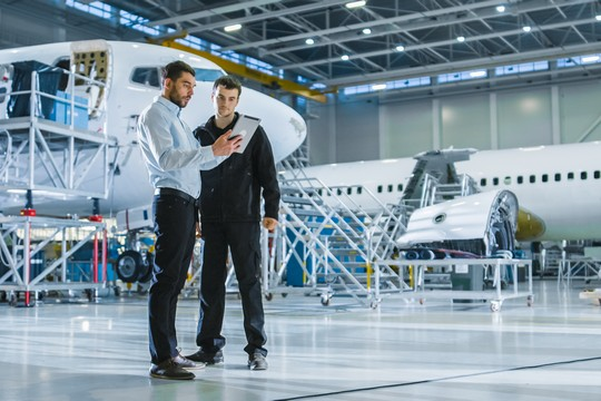 Aircraft Maintenance Worker and Engineer discussing SkyNav safety