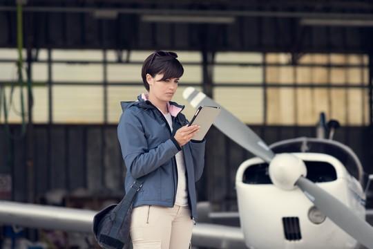 Pilot reviewing aviation language phraseology before flight
