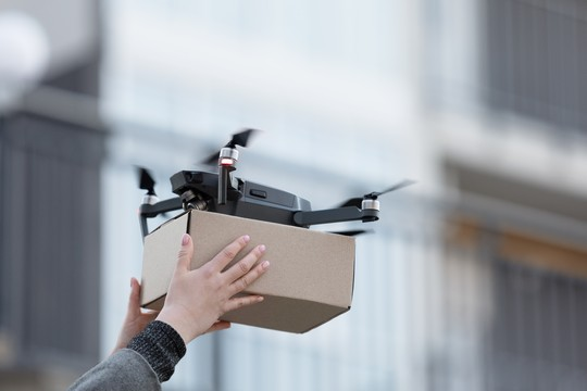 Delivery Drone delivering a package